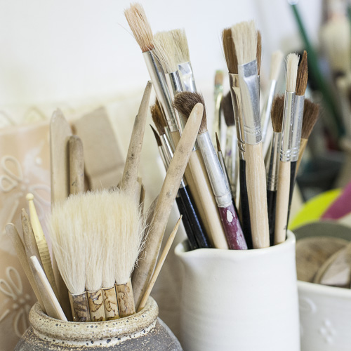 decorating brushes in pots used by Elaine Wells