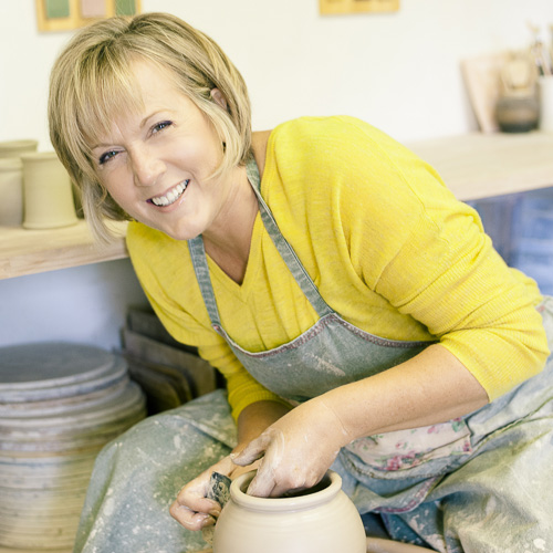 Elaine Wells at the potting table